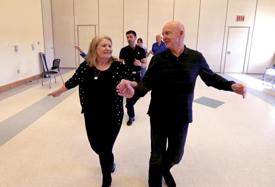 "Plymouth, MA - 2/08/2018 - Dance Instructor J Michael Winward, of ""Steps In Time,"" center rear, leads a ""Naughty Nookers"" dance class at Plymouth senior center. In foreground l to r are jeannette McKay and Rick Maloney. - (Barry Chin/Globe Staff), Section: Business, Reporter: Globe Staff, Topic: xxseniorstigma, LOID: 8.4.897192019."